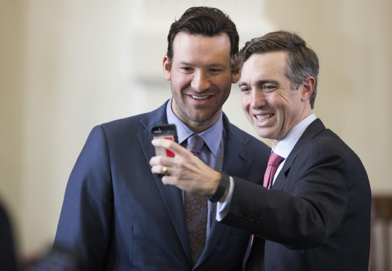 State Sen. Van Taylor, R-Plano, right, takes a selfie with Tony Romo. (AP)