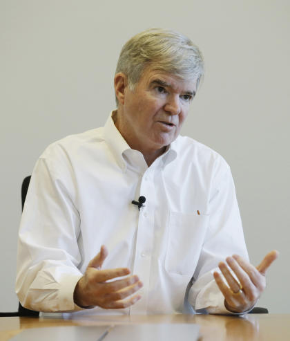 NCAA President Mark Emmert responds to a question during an interview Monday, Oct. 27, 2014, in Indianapolis. (AP Photo/Darron Cummings)