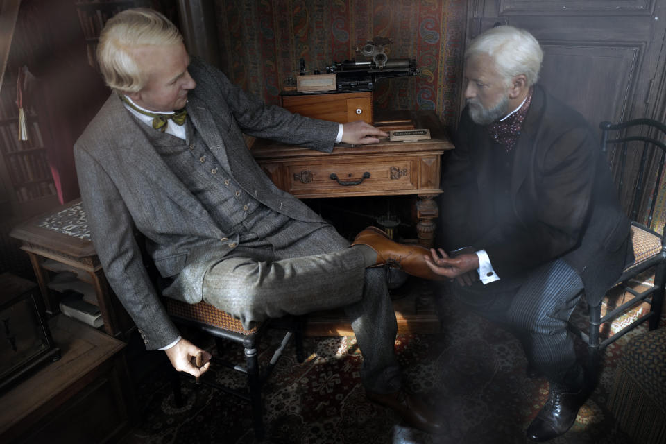Wax sculptures shows the visit of US physicist and inventor Thomas Edison, left, on September 10th, 1889, with French architect Gustave Eiffel, right, displayed in a small room on the third level during the opening up of the top floor of the Eiffel Tower, in Paris, Wednesday, July 15, 2020. The top floor of Paris' Eiffel Tower reopened today as the 19th century iron monument re-opened its first two floors on June 26 following its longest closure since World War II. (AP Photo/Francois Mori)