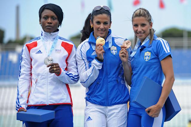 Silver medalist Teresa Nzola Meso Ba of France, gold medalist Athanasia Perra and bronze medalist Paraskevi Papachristou of Greece pose for the photographers after the Women's Triple Jump Final during the XVI Mediterranean Games on July 3, 2009 in Pescara, Italy. (Photo by Getty Images)