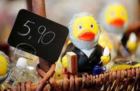 FILE PHOTO: A rubber duck depicting German philosopher Karl Marx is for sale at the price of 5.90 euro (about 7.30 U.S. dollars) at a souvenir shop in his hometown in Trier, Germany, April 13, 2018. REUTERS/Wolfgang Rattay/File Photo