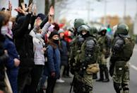 Belarusian law enforcement officers block protesters during a march of opposition supporters from central Minsk to a site of Stalin-era executions just outside the capital on November 1, 2020
