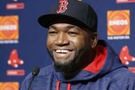 "FILE - In this Sept. 27, 2016, file photo, Boston Red Sox designated hitter David Ortiz laughs during a press conference at Yankee Stadium in New York. Actor John Krasinski and the retired Red Sox slugger announced Sunday, April 12, 2020, during Krasinski's ""Some Good News"" YouTube show that workers at Beth Israel Deaconess Medical Center in Boston would be getting free Red Sox tickets. (AP Photo/Kathy Willens, File)"