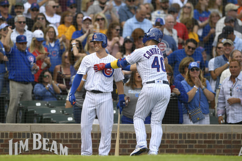 Chicago Cubs' Willson Contreras (40) celebrates with teammate Nico Hoerner left, after hitting a solo home run during the first inning of a baseball game against the Pittsburgh Pirates, Friday, Sept. 13, 2019, in Chicago. (AP Photo/Paul Beaty)