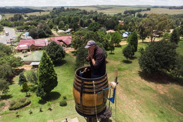 """Since November 14, home has been a 500-litre wine barrel -- a tight squeeze for Kruger, who nonetheless plans to sit tight until at least Monday -- though organiser Fiona Jones say he plans to stay """"a little longer"""" (AFP Photo/ANTOINE DEMAISON)"""