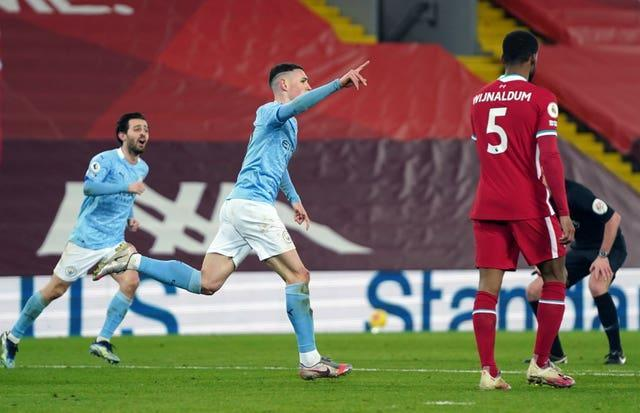 Manchester City's Phil Foden celebrates scoring at Anfield