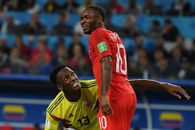 Colombia's defender Yerry Mina (L) and England's forward Raheem Sterling during the Russia 2018 World Cup round of 16 football match between Colombia and England at the Spartak Stadium in Moscow on July 3, 2018. (Getty Images)