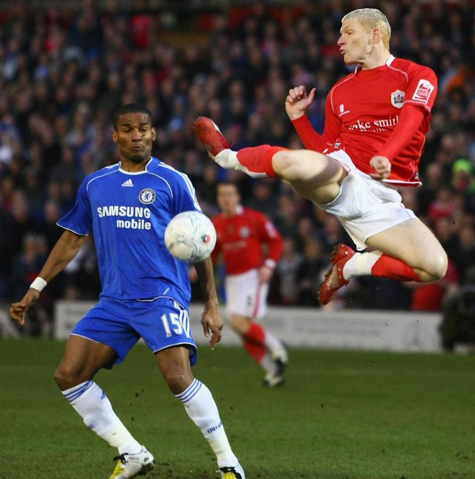 Bobby Hassell competes for possession with Chelsea's Florent Malouda.