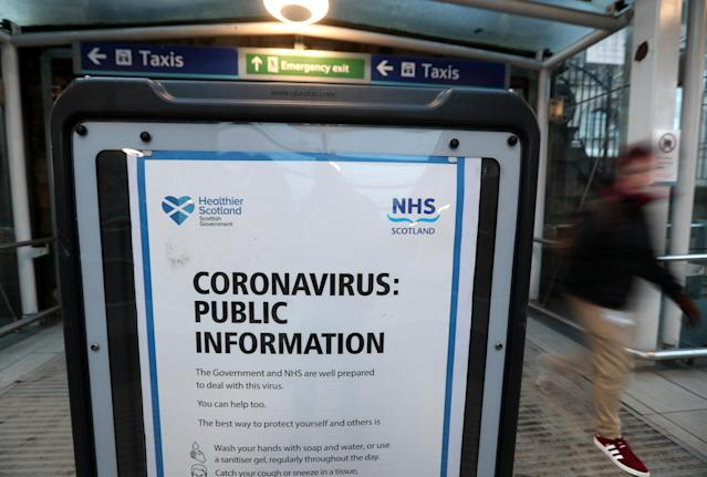 A coronavirus warning board at the entrance of a train station in Edinburgh on Friday. (Photo by Andrew Milligan/PA Images via Getty Images)