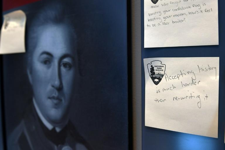 Visitors are asked to tussle with difficult questions about history at Arlington House and can write their response on sticky notes, such as this one that reads: 'Accepting history is much harder than re-writing it' (AFP/Olivier DOULIERY)