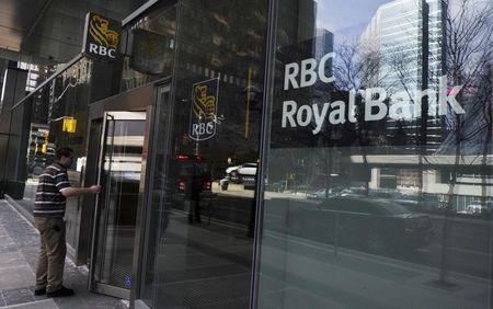 A man walks into a Royal Bank of Canada (RBC) in Toronto March 3, 2011. REUTERS/Mark Blinch