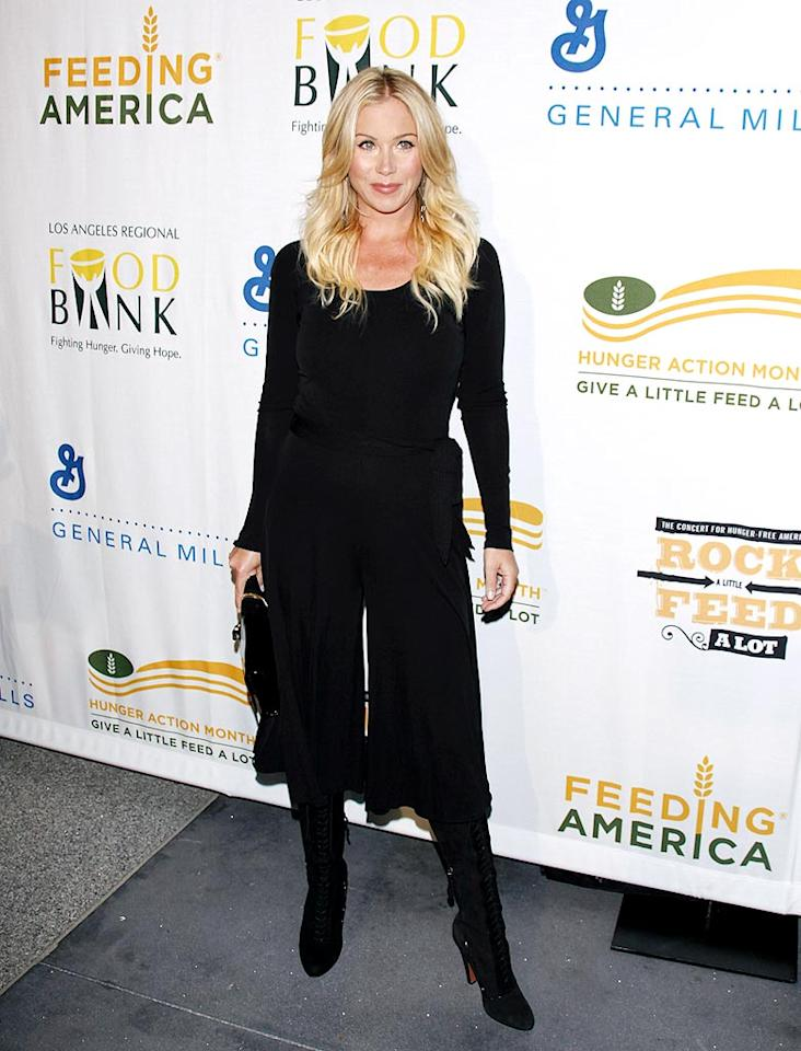 """Breast cancer survivor and blond bombshell Christina Applegate looked like a million bucks in an all-black getup. Jean Baptiste Lacroix/<a href=""""http://www.wireimage.com"""" target=""""new"""">WireImage.com</a> - September 29, 2009"""