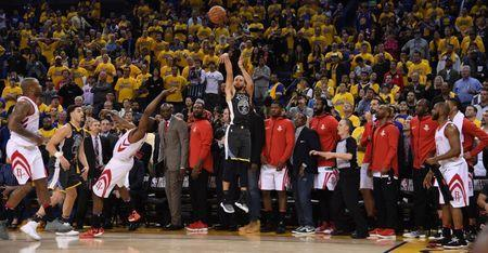 May 22, 2018; Oakland, CA, USA; Golden State Warriors guard Stephen Curry (30) shoots against the Houston Rockets during the fourth quarter in game four of the Western conference finals of the 2018 NBA Playoffs at Oracle Arena. Mandatory Credit: Kyle Terada-USA TODAY Sports
