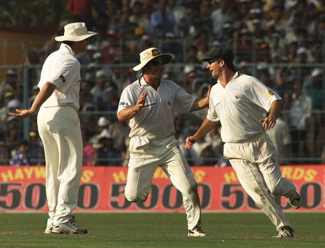 12 Mar 2001:  Steve Waugh (right) of Australia celebrates with team mates Michael Slater (centre) and Mark Waugh after catching Saurav Ganguly of India off Michael Kasprowicz's bowling for 23, during day two of the 2nd Test between India and Australia played at Eden Gardens, Calcutta, India. X DIGITAL IMAGE  Mandatory Credit: Hamish Blair/ALLSPORT