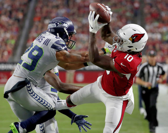 Seattle Seahawks safety Earl Thomas (29) was injured defending a touchdown pass to Arizona's Chad Williams. (AP)