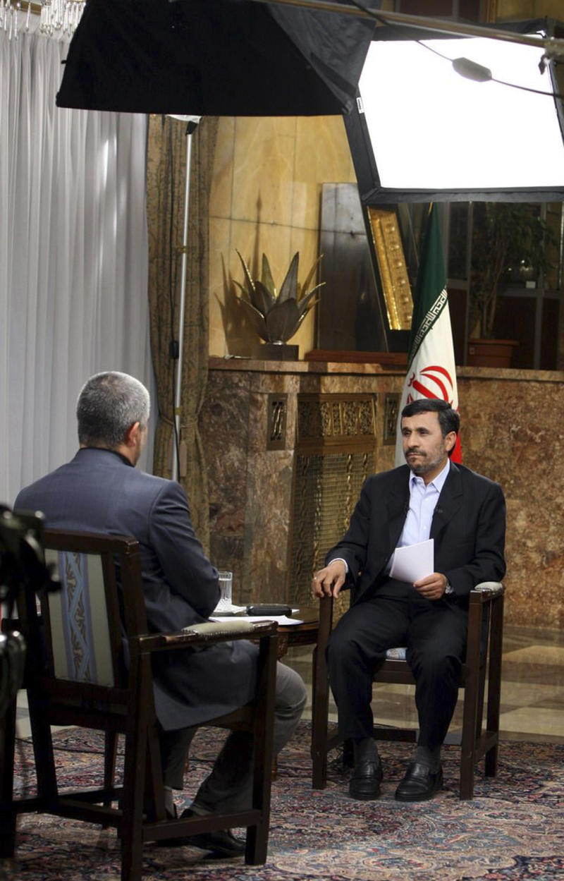 "This image provided by the Presidency Office shows Iranian President Mahmoud Ahmadinejad, right, attending an interview with state-run TV at the presidency in Tehran, Iran, Saturday, Dec. 18, 2010. Iranian President Mahmoud Ahmadinejad on Saturday called recent talks with six world powers in Switzerland ""positive,"" a sign that Tehran may be willing to address concerns about its disputed nuclear program. An unidentified interviewer sits at left. (AP Photo/Presidency Office, Ebrahim Seyyedi, HO)"