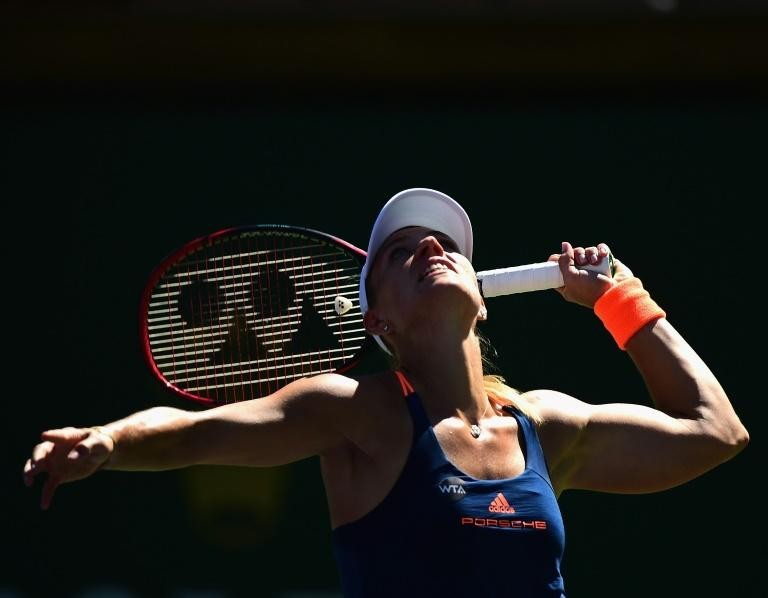 Angelique Kerber serves during her straight set win over Andrea Petkovic of Germany at Indian Wells Tennis Garden