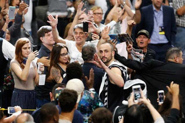 "<a class=""link rapid-noclick-resp"" href=""/nba/players/3380/"" data-ylk=""slk:Manu Ginobili"">Manu Ginobili</a> waves to Spurs fans as he leaves the court for perhaps the last time. (Getty Images)"