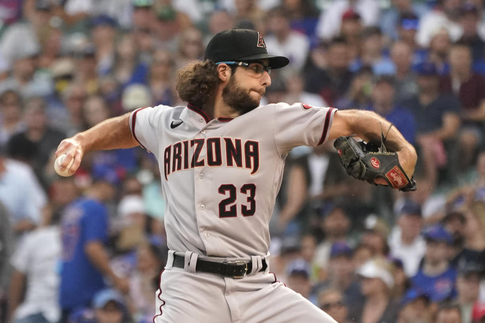 Arizona Diamondbacks starting pitcher Zac Gallen throws against the Chicago Cubs during the first inning of a baseball game in Chicago, Friday, July 23, 2021. (AP Photo/Nam Y. Huh)