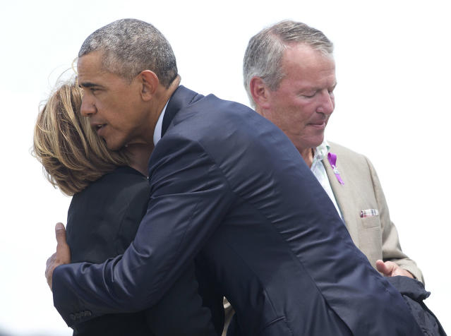 <p>President Obama hugs Orange County Mayor Teresa Jacobs, accompanied by Orlando, Mayor Buddy Dyer, right, on the tarmac upon his arrival at Orlando International Airport, June 16, 2016. (AP/Pablo Martinez Monsivais) </p>