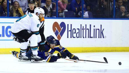 May 23, 2016; St. Louis, MO, USA; San Jose Sharks center Joe Pavelski (8) and St. Louis Blues defenseman Colton Parayko (55) fight for a loose puck in game five of the Western Conference Final of the 2016 Stanley Cup Playoffs at Scottrade Center. Mandatory Credit: Billy Hurst-USA TODAY Sports