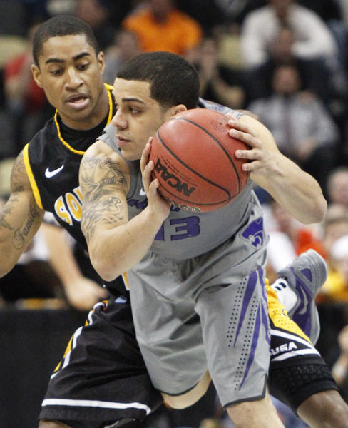 Kansas State's Angel Rodriguez (13) gets control of a loose ball in front of Southern Mississippi's Neil Watson, left, defends in the first half of an East Regional NCAA tournament second-round college basketball game on Thursday, March 15, 2012, in Pittsburgh. (AP Photo/Keith Srakocic)