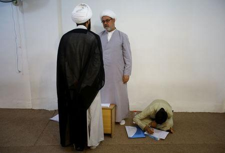 Star Jaber Al-Busaisi (C), 58, a teacher at Ibn al-Fahd al-Heli school run by al-Hawza al-Ilmiyya, speaks to the principal of the school, in Kerbala, Iraq, August 4, 2017. For more than 1,000 years, the al-Hawza al-Ilmiyya in southern Baghdad has been giving religious instructions to thousands of Shi'ite Muslims to help them become clerics. REUTERS/Abdullah Dhiaa Al-deen