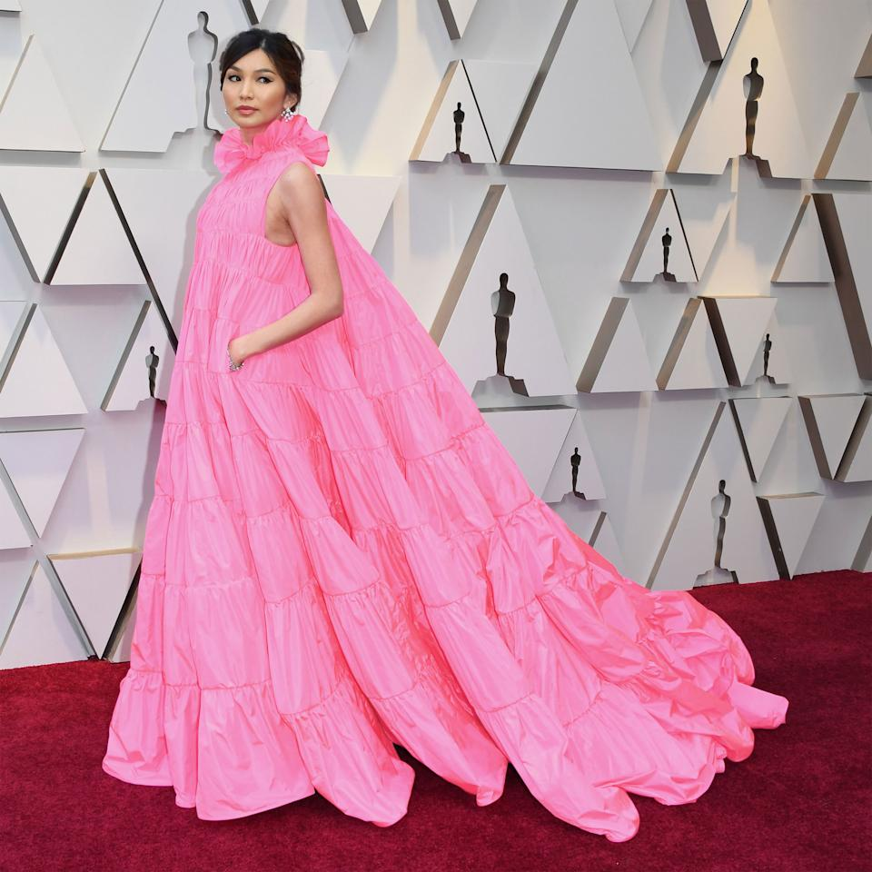 <p>Chan hit a fashion peak at the Oscars in this voluminous Valentino Haute Couture number, complete with a ruffled collar, a sweeping train, and pockets that she revealed were stuffed with chocolate chip cookies. </p>