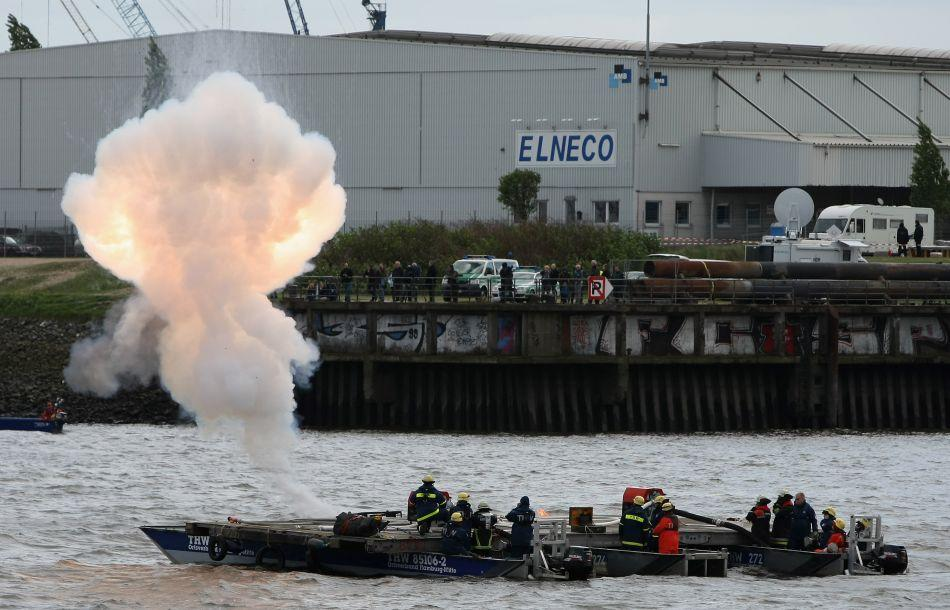 Firefighters set off an explosion as part of a demonstration sea rescue operation.