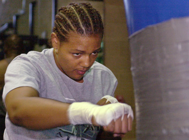 FILE - In this June 16, 2000, file photo, Freeda Foreman works out in a gym in Las Vegas. The 42-year-old daughter of former heavyweight champion George Foreman died at a Houston-area home. The Harris County sheriff's office said deputies were called Friday, March 8, 2019, to the home where EMS had determined Freeda George Foreman was dead. (AP Photo/Laura Rauch, File)