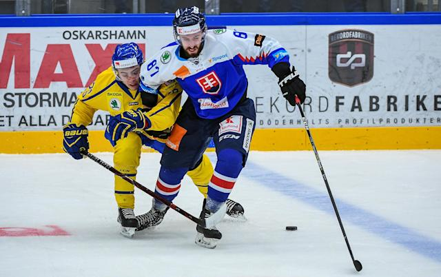 Ice Hockey - 2018 Euro Hockey Challenge - Sweden v Slovakia - Oskarshamn, Sweden - April 6, 2018 - Sweden's Erik Brannstrom battles with Slovakia's Patrik Svitan. TT News Agency/Suvad Mrkonjic/via REUTERS ATTENTION EDITORS - THIS IMAGE WAS PROVIDED BY A THIRD PARTY. SWEDEN OUT. NO COMMERCIAL OR EDITORIAL SALES IN SWEDEN