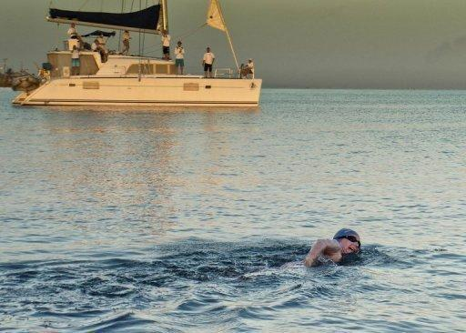 British-Australian swimmer Penny Palfrey, pictured leaving Havana on June 29, who was trying to swim unassisted from Cuba to Florida, has given up her quest, her team announced Sunday