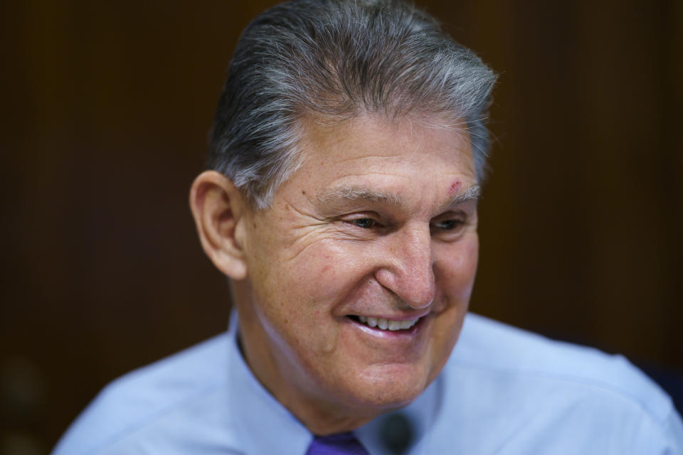 Sen. Joe Manchin, D-W.Va., prepares to chair a hearing in the Senate Energy and Natural Resources Committee, as lawmakers work to advance the $1 trillion bipartisan bill, at the Capitol in Washington, Thursday, Aug. 5, 2021. (AP Photo/J. Scott Applewhite)