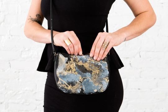 Marbled spray paint is the perfect addition to an old bag.