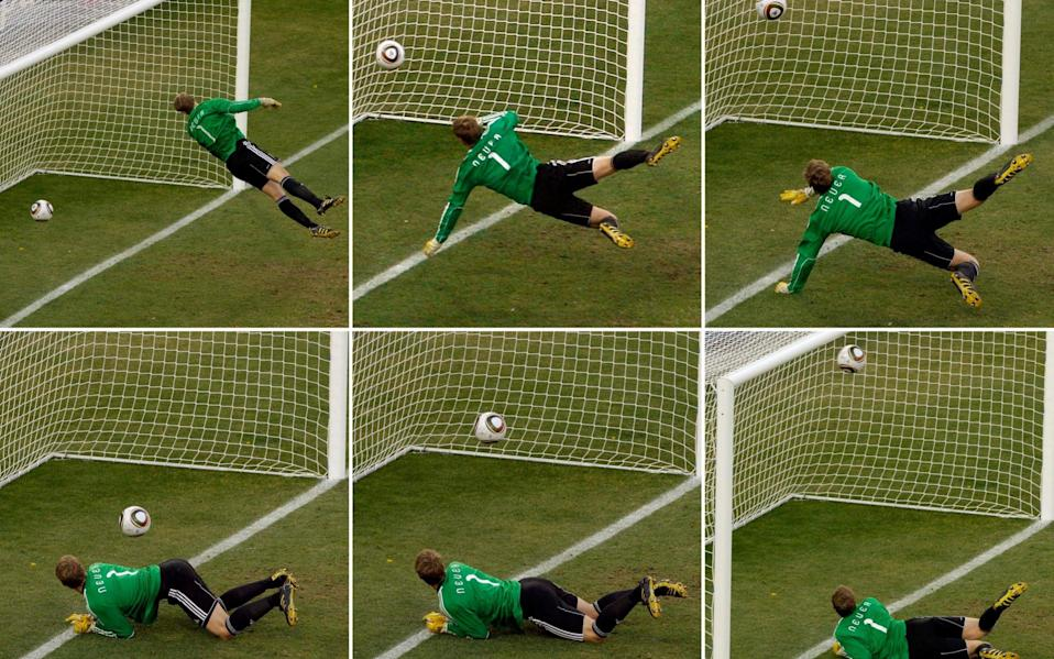 Germany's goalkeeper Manuel Neuer looks at a ball that hit the bar to bounce over the line - AP