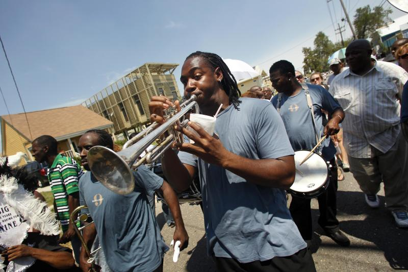 A member of the Big 9 marching club plays trumpet in a second line  commemorating the sixth anniversary of Hurricane Katrina in New Orleans, Monday, Aug. 29, 2011. (AP Photo/Gerald Herbert)