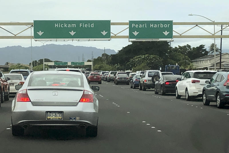 Traffic backs up at the main gates after a shooting at Pearl Harbor Naval shipyard, Wednesday, Dec. 4, 2019, near Pearl Harbor in Honolulu. (AP Photo/Caleb Jones)