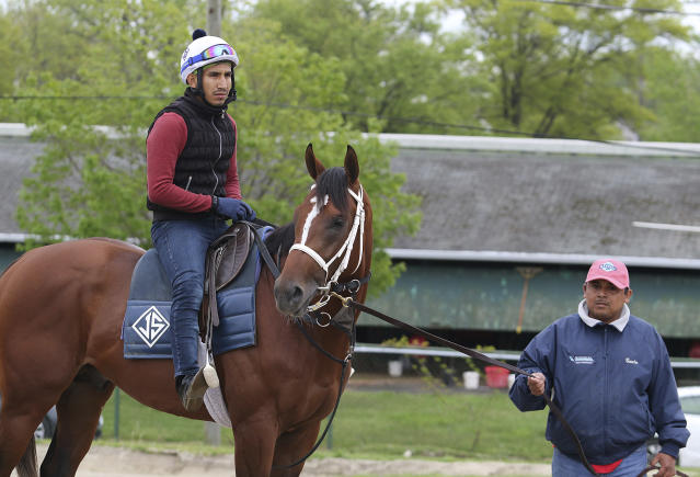 Maximum Security, with exercise rider Edelberto Rivas aboard, is held by assistant trainer Jose Hernandez, at Monmouth Park in Oceanport, N.J. on Thursday morning May 9, 2019, before heading to the track for the first time since the Kentucky Derby. (Bill Denver/EQUI-PHOTO via AP)