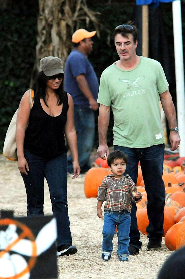 """Chris Noth of """"Sex and the City"""" gets away from the sex <i>and</i> the city, taking a stroll through piles of hay and stacks of pumpkins with fiancee Tara Lynn Wilson and their 1-year-old son, Orion. <a href=""""http://www.pacificcoastnews.com/"""" target=""""new"""">PacificCoastNews.com</a> - October 25, 2009"""