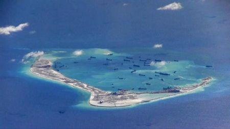 Still image from United States Navy video purportedly shows Chinese dredging vessels in the waters around Mischief Reef in the disputed Spratly Islands