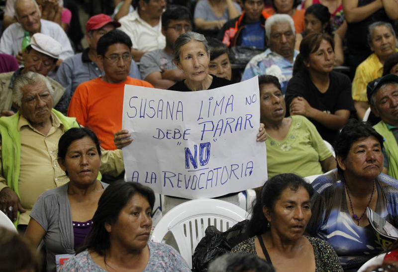 """In this Feb. 8, 2013 photo, a supporter of Lima's Mayor Susana Villaran holds a sign that reads in Spanish """"Susana, Lima, should not stop, no to the recall"""" at a meeting between Villaran and newspaper vendors in Lima, Peru. Villaran, a 63-year-old career human rights defender and the first woman ever elected to manage Peru's capital, is fighting for her political life in a March 17 recall election that she says was organized by the very power brokers she has disenfranchised. (AP Photo/Martin Mejia)"""