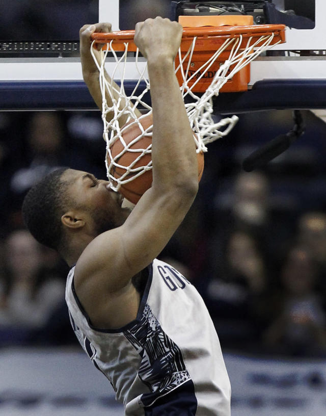 Georgetown forward Mikael Hopkins (3) hits himself with the ball as he dunks during the first half of an NCAA college basketball game against Seton Hall, Saturday, Jan. 18, 2014, in Washington. (AP Photo/Alex Brandon)