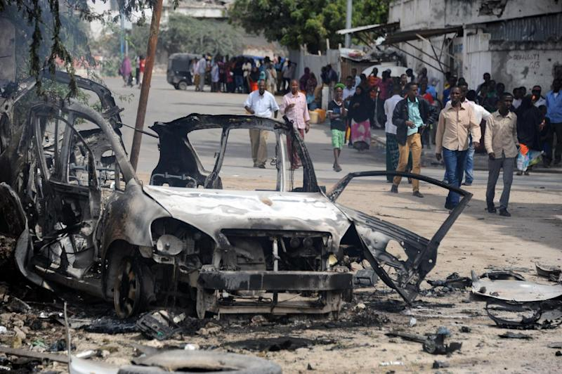 A burned out car marks the site of a major car bomb by Shebab insurgents in Mogadishu, on August 31, 2014 (AFP Photo/)