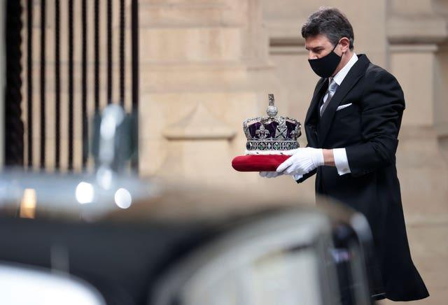 The Imperial State Crown is taken to the Palace of Westminster