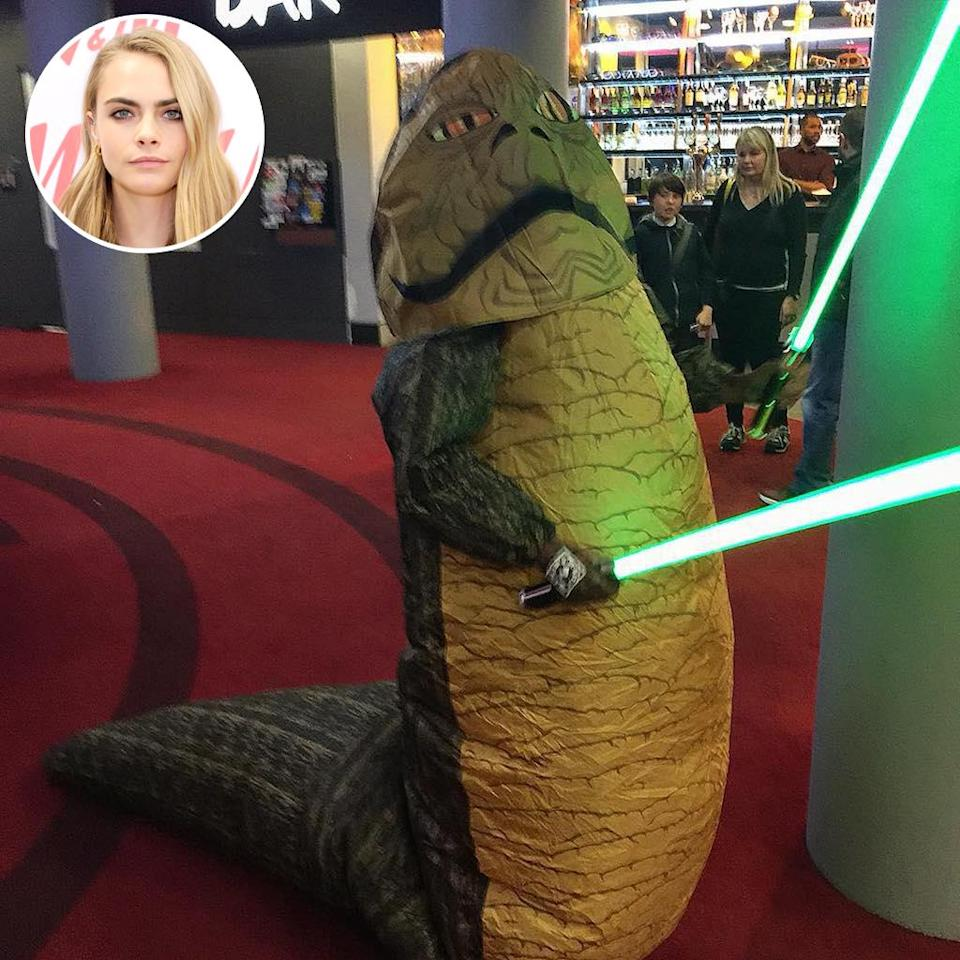 """<p>The model trotted out one of her, ah, less conventional looks ' call it Jabba the Hut couture — for the <em>Star Wars</em> installment released in December 2015. She explained that she was """"<a rel=""""nofollow noopener"""" href=""""https://www.instagram.com/p/_cZPPSjKK-/"""" target=""""_blank"""" data-ylk=""""slk:watching Star Wars in style."""" class=""""link rapid-noclick-resp"""">watching <em>Star Wars</em> in style.</a>"""" (Photo: Cara Delevingne via Instagram/Getty Images) </p>"""