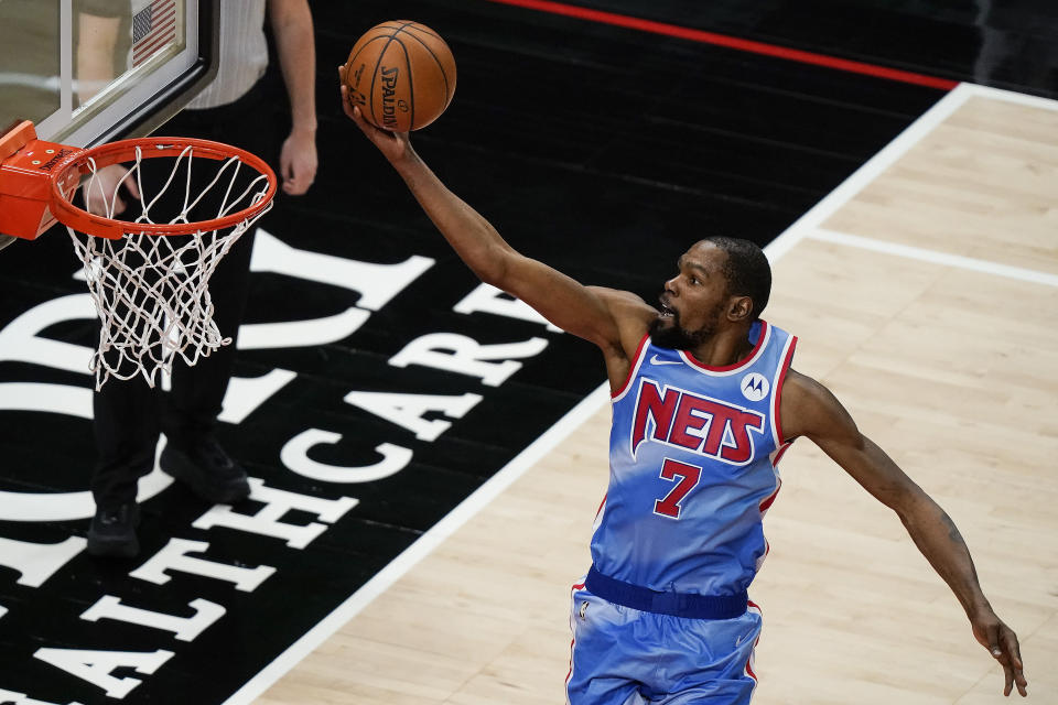 Brooklyn Nets forward Kevin Durant scores against the Atlanta Hawks during the second half of an NBA basketball game Wednesday, Jan. 27, 2021, in Atlanta. (AP Photo/Brynn Anderson)