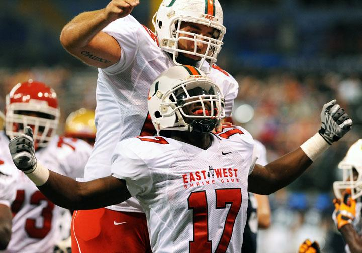 ST. PETERSBURG, FL - JANUARY 21: Wide receiver LaRon Byrd #17 of the Miami Hurricanes celebrates a touchdown catch with center Tyler Horn #65 during the 87th annual East-West Shrine game January 21, 2012 at Tropicana Field in St. Petersburg, Florida. (Photo by Al Messerschmidt/Getty Images)