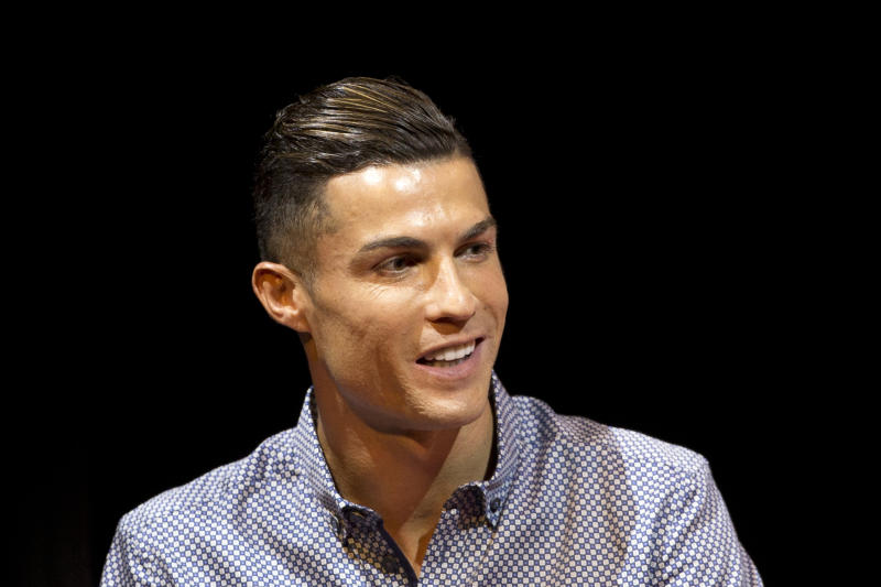 FILE - In this Monday, July 29, 2019 file photo Juventus soccer player Cristiano Ronaldo speaks in Madrid, Spain. Ronaldo's lawyers are trying to push a Nevada woman's lawsuit accusing the Portuguese soccer star of raping her in Las Vegas in 2009 out of federal court and into private arbitration. Attorneys for Ronaldo's accuser, Kathryn Mayorga, didn't immediately respond Wednesday, Aug. 14, 2019 to messages about documents filed Aug. 8. They asked a judge to declare a confidentiality agreement and $375,000 hush-money settlement with Mayorga still in effect. (AP Photo/Paul White,File)