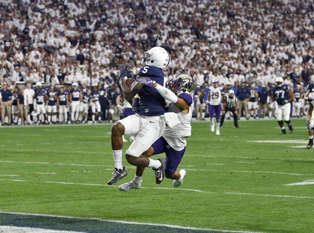 "Penn State wide receiver <a class=""link rapid-noclick-resp"" href=""/ncaaf/players/230149/"" data-ylk=""slk:DaeSean Hamilton"">DaeSean Hamilton</a> (5) pulls in a touchdown catch as Washington defensive back Myles Bryant defends during the second half of the Fiesta Bowl NCAA college football game, Saturday, Dec. 30, 2017, in Glendale, Ariz. (AP Photo/Ross D. Franklin)"