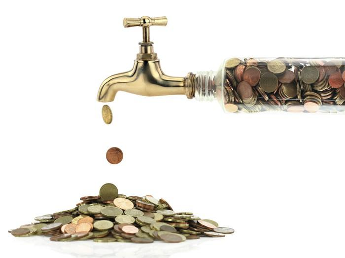 Coins coming from a water faucet